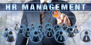 Businessman is touching HR MANAGEMENT on an interactive control screen. Business concept for talent acquisition E-Recruiting HR information systems HRM HR and Human Resource Management.